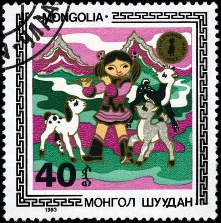 mongolia: MONGOLIA - CIRCA 1983: A Stamp printed in MONGOLIA shows the Girl and Animals, from the series Children in Various Activities, circa 1983 Stock Photo