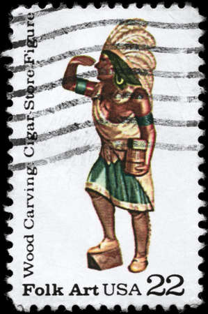 perforated stamp: USA - CIRCA 1986: A Stamp printed in USA shows the Cigar Store Figure from the series American Folk Art, Wood Carving, circa 1986 Stock Photo