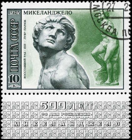 USSR - CIRCA 1975: A Stamp printed in USSR shows the sculpture Rebellious Slave (1513), Louvre, Paris, from the series Works by Michelangelo, circa 1975 photo