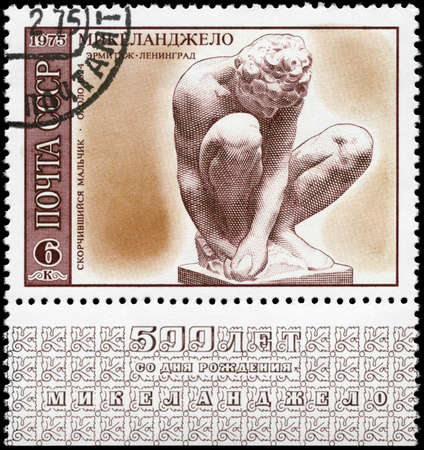 USSR - CIRCA 1975: A Stamp printed in USSR shows the sculpture Squatting Boy (1524), Hermitage, St.Petersburg, from the series Works by Michelangelo, circa 1975 photo