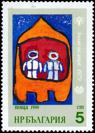 puerile: BULGARIA - CIRCA 1980: A Stamp printed in BULGARIA shows the Children�s drawing and IYC emblem, from the series