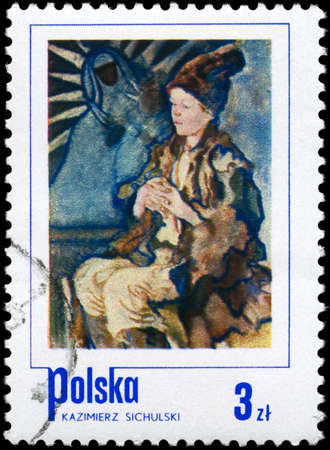 threadbare: POLAND - CIRCA 1974: A Stamp printed in POLAND shows the Peasant Boy, by Kazimierz Sichulski, from the series Polish paintings of Children, circa 1974