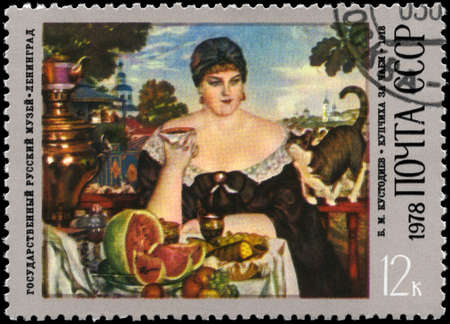 USSR - CIRCA 1978: A Stamp printed in USSR shows the Merchant�s Wife Drinking Tea, from the series B.M. Kustodiev (1878-1927) Paintings, circa 1978 photo