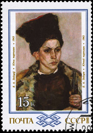 papakha: USSR - CIRCA 1983: A Stamp printed in USSR shows the painting Young Partisan, by E.A. Zaitsev, 1943, from the series Paintings by White Russians, circa 1983