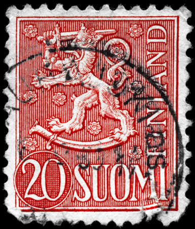 FINLAND - CIRCA 1956: A Stamp printed in FINLAND shows the Heraldic Lion, series, circa 1956 photo