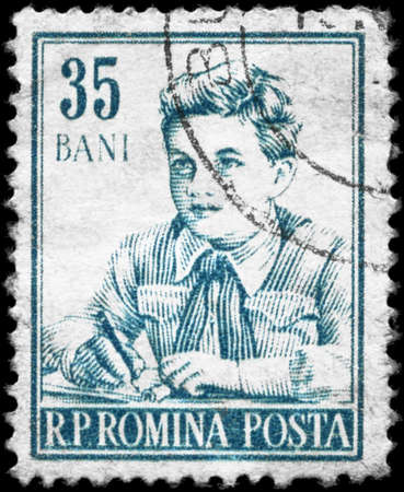 ROMANIA - CIRCA 1955: A Stamp printed in ROMANIA shows the portrait of a Pioneer, series, circa 1955 photo