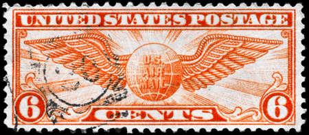 USA - CIRCA 1934: A Stamp printed in USA shows the Winged Globe, circa 1934 photo