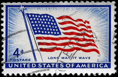 USA - CIRCA 1957: A Stamp printed in USA shows the Flag Old Glory (48 Stars), with the inscription Long may it wave, circa 1957 photo