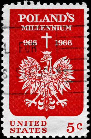 USA - CIRCA 1966: A Stamp printed in USA shows the Polish Eagle and Cross, devoted to 1000th anniv. of the adoption of Christianity in Poland, circa 1966 Stock Photo - 11616100