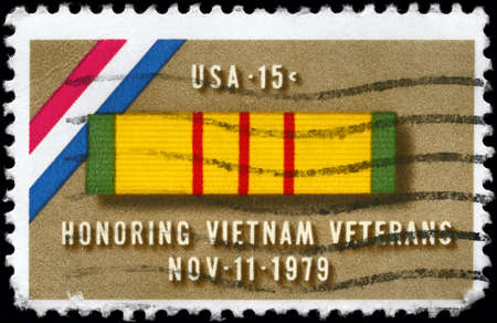 USA - CIRCA 1979: A Stamp printed in USA shows the Ribbon for Vietnam Service Medal, devoted to veterans of the Vietnam War, circa 1979  photo