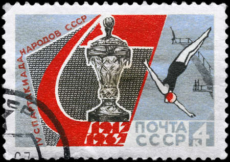USSR - CIRCA 1967: A Stamp printed in USSR shows the Cup and Diver, from the series 4th Natl. Spartacist Games,  USSR 50th anniv., circa 1967 Stock Photo - 11616517