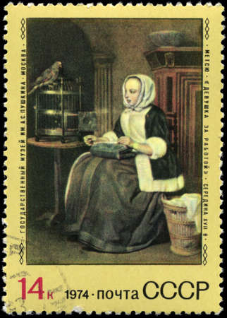 perforated stamp: USSR - CIRCA 1974: A Stamp printed in USSR shows the Girl at Work, by Gabriel Metsu, series, circa 1974 Stock Photo