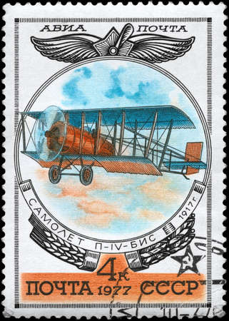 USSR - CIRCA 1977: A Stamp printed in USSR shows the Aviation Emblem and P-4 BIS biplane (1917), from the series Aviation 1917-1930, circa 1977 photo