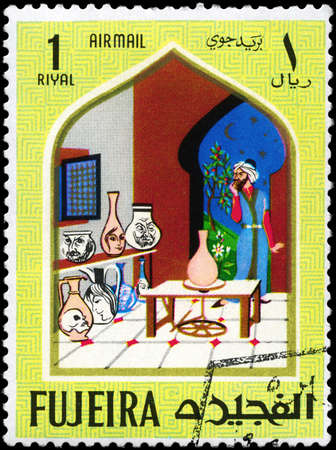 lamp of aladdin: FUJEIRA - CIRCA 1967: A Stamp printed in FUJEIRA shows Scenes from the fairy tale Aladdin and the Magic Lamp, from the series Oriental Tales, circa 1967