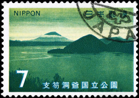 JAPAN - CIRCA 1971: A Stamp printed in JAPAN shows the Mt. Yotei from Lake Toya, from the series Shikotsu-Toya National Park, circa 1971 photo