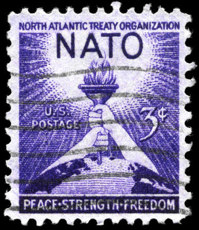 USA - CIRCA 1952: A Stamp printed in USA shows the Torch of Liberty and Globe, devoted to 3rd anniv. of the signing of the North Atlantic Treaty, circa 1952 Stock Photo - 11616930
