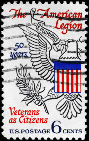 USA - CIRCA 1969: A Stamp printed in USA shows the Eagle from Great Seal of U.S., devoted to American Legion, 50th Anniv., circa 1969 photo
