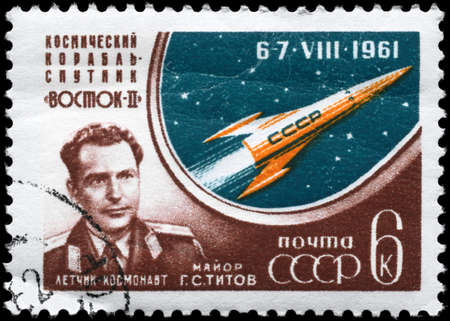 vostok: USSR - CIRCA 1961: A Stamp printed in USSR shows the Major Titov and Vostok 2, series, circa 1961 Stock Photo
