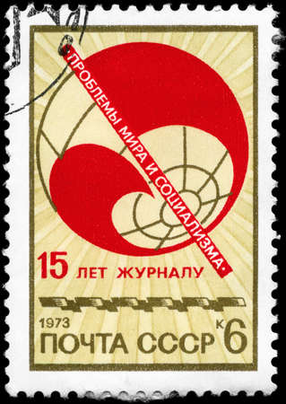 USSR - CIRCA 1973: A Stamp printed in USSR devoted to 15th anniversary of the international communist review �Problems of Peace and Socialism�, circa 1973 photo