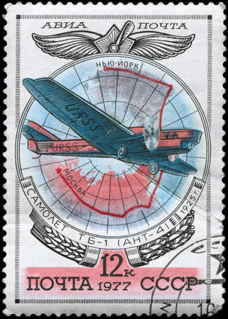 USSR - CIRCA 1977: A Stamp printed in USSR shows the Aviation Emblem and TB-1 (ANT-4) monoplane (1925), from the series Aviation 1917-1930, circa 1977 photo
