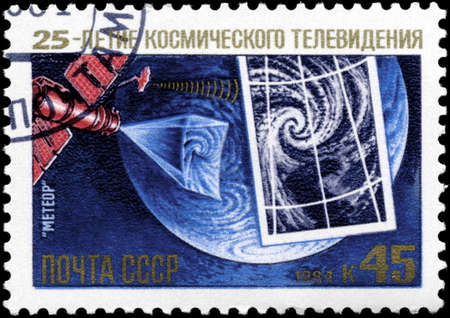 USSR - CIRCA 1984: A Stamp printed in USSR shows the Meteor Satellite, from the series Television from Space, 25th Anniv., circa 1984 photo