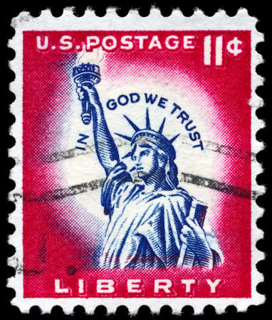 in god we trust: USA - CIRCA 1956: A Stamp printed in USA shows the Statue of Liberty, with the inscription In God we trust, circa 1956
