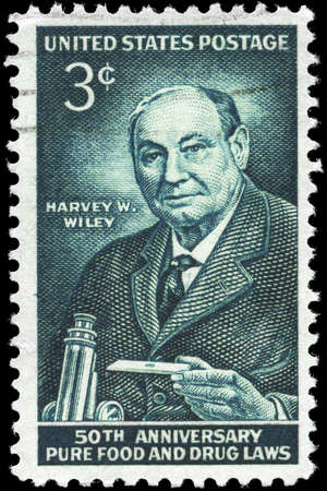 USA - CIRCA 1956: A Stamp printed in USA shows the portrait of a Harvey W. Wiley (1844-1930), devoted to 50th Anniversary Pure Food and Drug Laws, circa 1956 photo