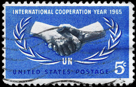 USA - CIRCA 1965: A Stamp printed in USA shows the International Cooperation Year Issue, and 20th anniv. of the UN, circa 1965 photo