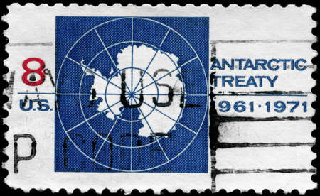 USA - CIRCA 1971: A Stamp printed in USA shows the Map of Antarctica and devoted to 10th anniv. of the Antarctic Treaty, circa 1971 photo