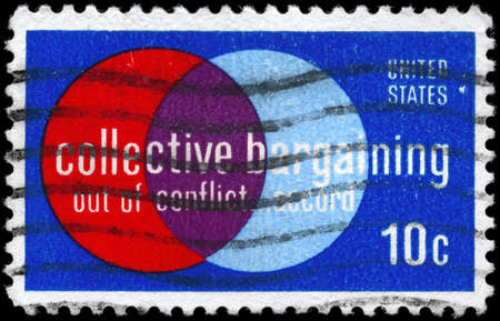 collective bargaining: USA - CIRCA 1975: A Stamp printed in USA devoted to Collective Bargaining Law, enacted 1935 with Wagner Act. Imperfs., circa 1975 Stock Photo
