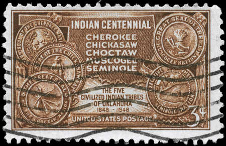chickasaw: USA - CIRCA 1948: A Stamp printed in USA shows the Map of Indian Territory & Seals of five Tribes, centennial issue, circa 1948