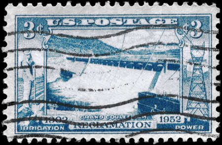 USA - CIRCA 1952: A Stamp printed in USA shows the Spillway, Grand Coulee Dam, 50 years of federal cooperation in developing the resources, circa 1952