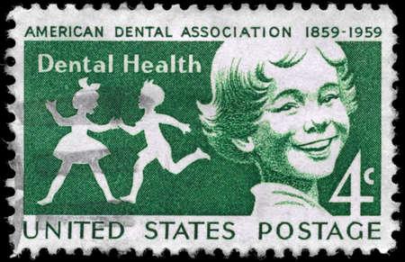 dental symbol: USA - CIRCA 1959: A Stamp printed in USA shows a Children, American Dental Association century, circa 1959 Editorial