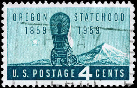 statehood: USA - CIRCA 1959: A Stamp printed in USA shows the covered Wagon and Mount Hood, Oregon Statehood Centenary, circa 1959 Editorial