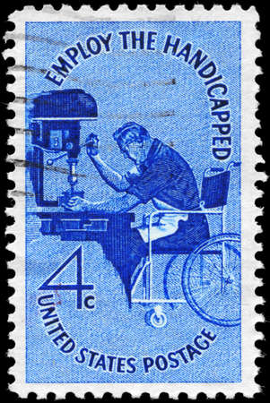 workmanship: USA - CIRCA 1960: A Stamp printed in USA shows a Man in Wheelchair operating Drill Press, Employ the Handicapped Issue, circa 1960