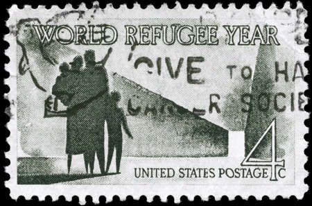 USA - CIRCA 1960: A Stamp printed in USA shows the Refugee Family walking toward New Life, World Refugee Year Issue, circa 1960