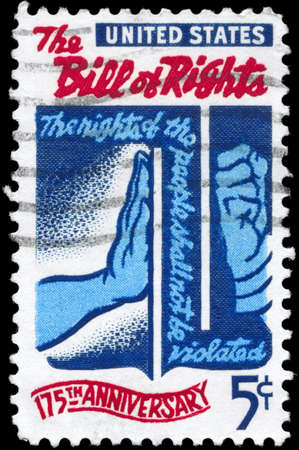 bill of rights: USA - CIRCA 1966: A Stamp printed in USA shows the Freedom checking Tyranny, devoted to Bill of Rights, 175th Anniversary, circa 1966