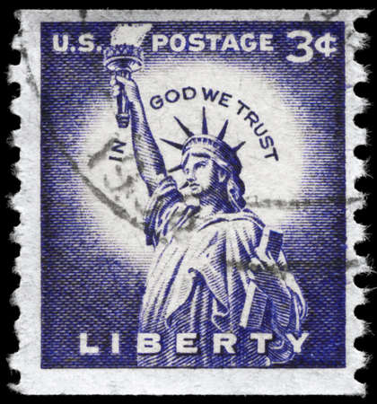 USA - CIRCA 1966: A Stamp printed in USA shows the Statue of Liberty, with the inscription In God we trust, circa 1966