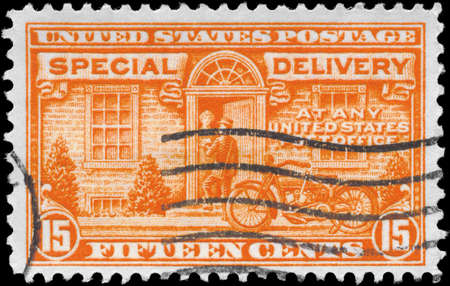 USA - CIRCA 1931: A Stamp printed in USA shows the Postman and Motorcycle, series, circa 1931 photo