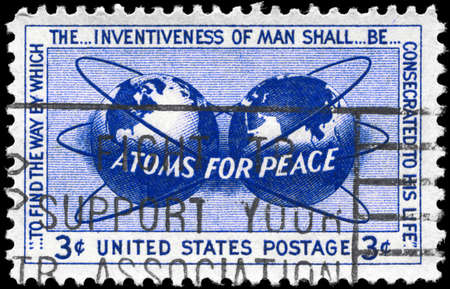 encircling: USA - CIRCA 1955: A Stamp printed in USA shows the Atomic Energy Encircling the Hemispheres, Atoms for Peace Policy, circa 1955 Editorial