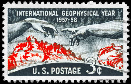 geophysical: USA - CIRCA 1958: A Stamp printed in USA shows the Solar Disc and Hands from Michelangelo�s �Creation of Adam, Geophysical Year (IGY, 1957-58), circa 1958
