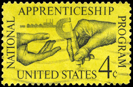 apprenticeship: USA - CIRCA 1962: A Stamp printed in USA shows the Machinist handing Micrometer to Apprentice, Apprenticeship Issue, circa 1962