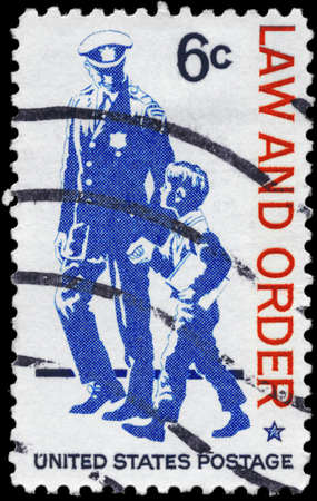 USA - CIRCA 1968: A Stamp printed in USA shows Policeman and small Boy, Law and Order Issue, circa 1968 photo