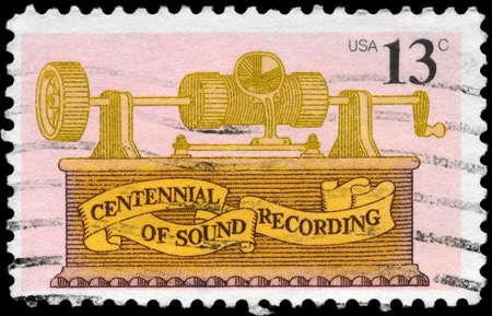 USA - CIRCA 1977: A Stamp printed in USA shows the tin foil Phonograph, by Thomas Alva Edison, Sound Recording Issue, circa 1977 photo