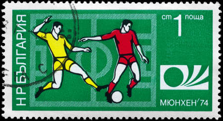BULGARIA - CIRCA 1974: A Stamp printed in BULGARIA shows the Soccer Players, Football Field and Munich 74 World Cup Emblem, series, circa 1974 photo