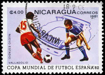 NICARAGUA - CIRCA 1981: A Stamp printed in NICARAGUA shows the Soccer Players and Contour of Stadium, Spain 82 world cup, circa 1981 photo
