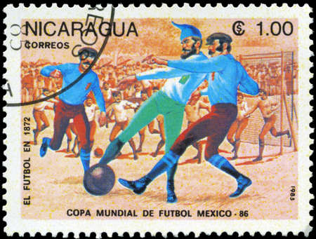 NICARAGUA - CIRCA 1985: A Stamp printed in NICARAGUA shows the Evolution of Soccer (1500), World Cup Soccer Championships, Mexico, circa 1985 photo
