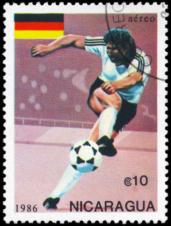 NICARAGUA - CIRCA 1986: A Stamp printed in NICARAGUA shows the Soccer Player and Flag of Germany, World Cup Championships, Mexico, circa 1986 photo