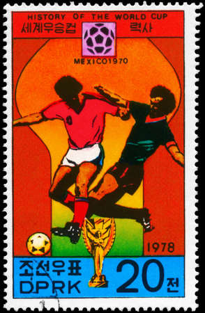 NORTH KOREA - CIRCA 1978: A Stamp printed in NORTH KOREA shows the Soccer players and championship emblem, Mexico 1970, History of the World Cup, circa 1978