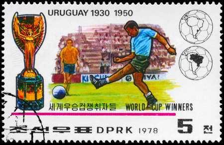 NORTH KOREA - CIRCA 1978: A Stamp printed in NORTH KOREA shows the Soccer players, Cup and Globe, Uruguay (1930, 1950), World Cup Winners, circa 1978